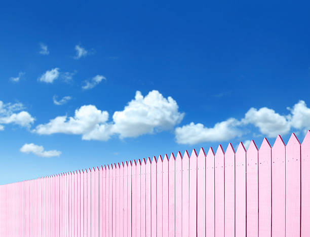 pink fence - palisade boundary stock photos and pictures