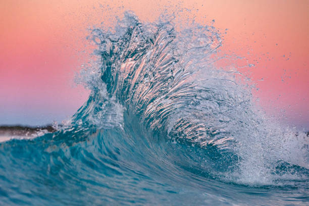 Pink flare in the ocean stock photo
