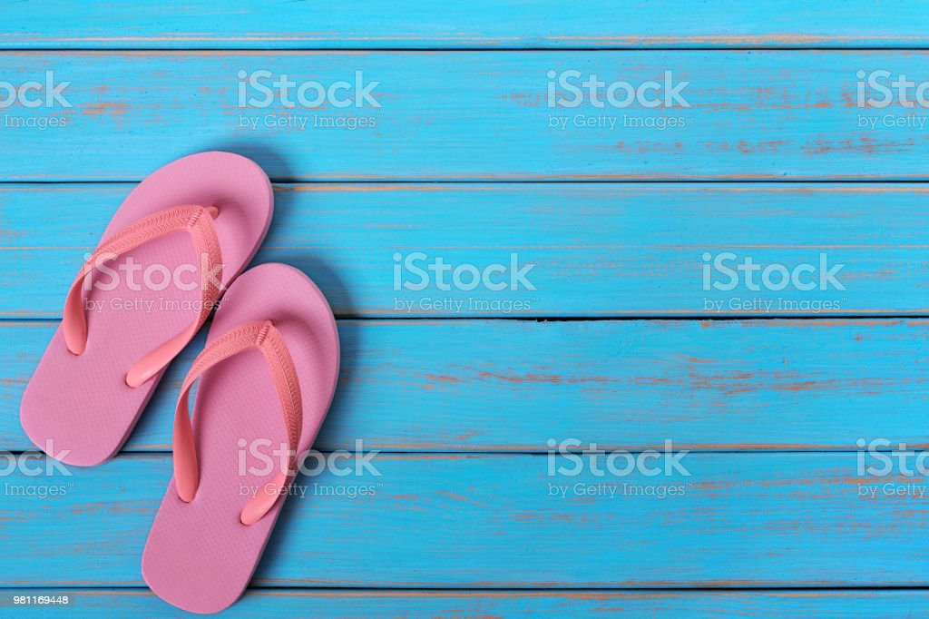 89295941e6f3ed Pink flip flop sandals old summer beach wood background painted blue  royalty-free stock photo