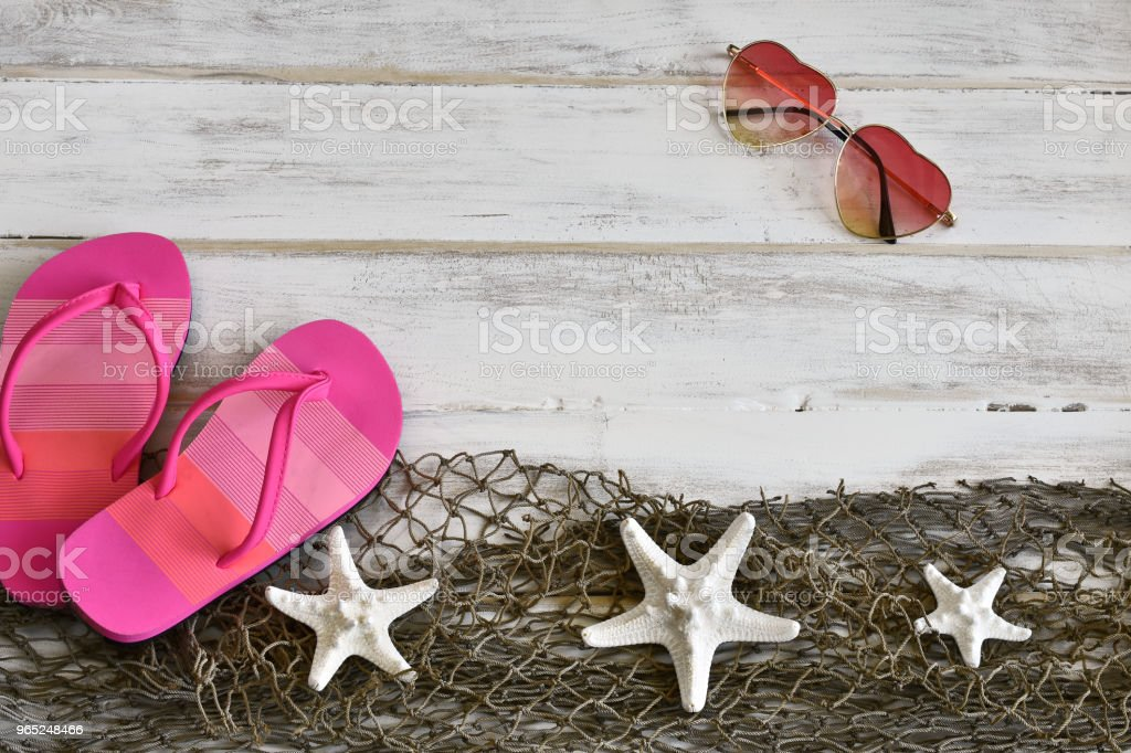 Pink Flip-Flops and White Starfish Background royalty-free stock photo