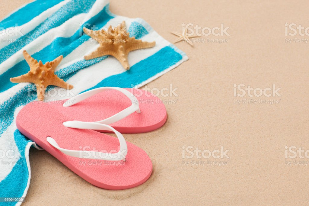 eb26ed28ce60 Pink flip-flops on beach holiday vacation background. royalty-free stock  photo