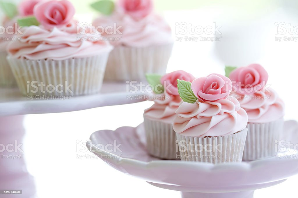 Pink flower cupcakes on pink plates royalty-free stock photo