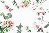 istock Pink flowers and eucalyptus branches. Flat lay, top view 912277788