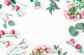 istock Pink flowers and eucalyptus branches. Flat lay, top view 938301886