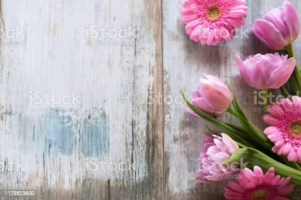Pink flowers on old gray wood picture id1129823600?b=1&k=6&m=1129823600&s=612x612&h=0fgkva kodj arqidj5w kglcax1a8sqqpcrz64bst8=