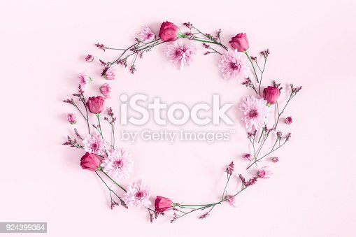 istock Pink flowers on pink background. Flat lay, top view 924399364