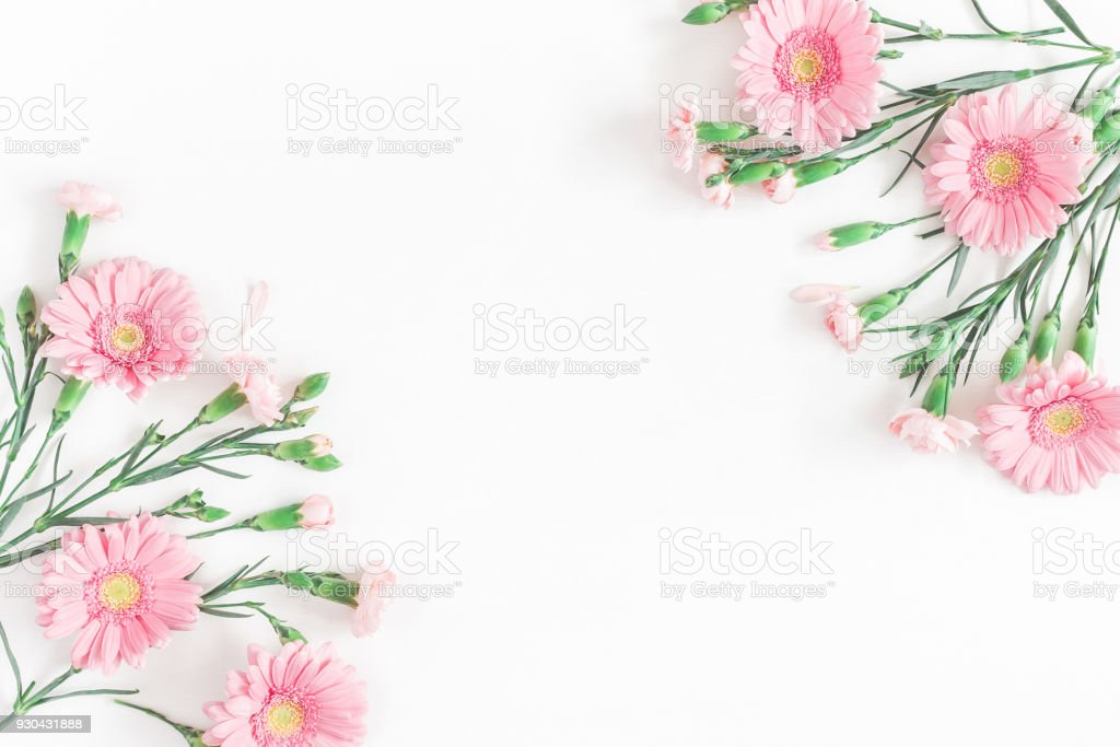 Pink flowers on white background flat lay top view stock photo pink flowers on white background flat lay top view royalty free stock photo mightylinksfo