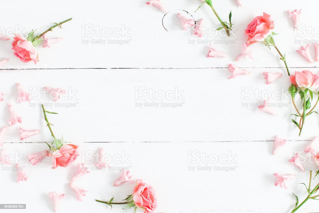 Pink flowers on white wooden background flat lay top view stock pink flowers on white wooden background flat lay top view royalty free stock mightylinksfo Gallery