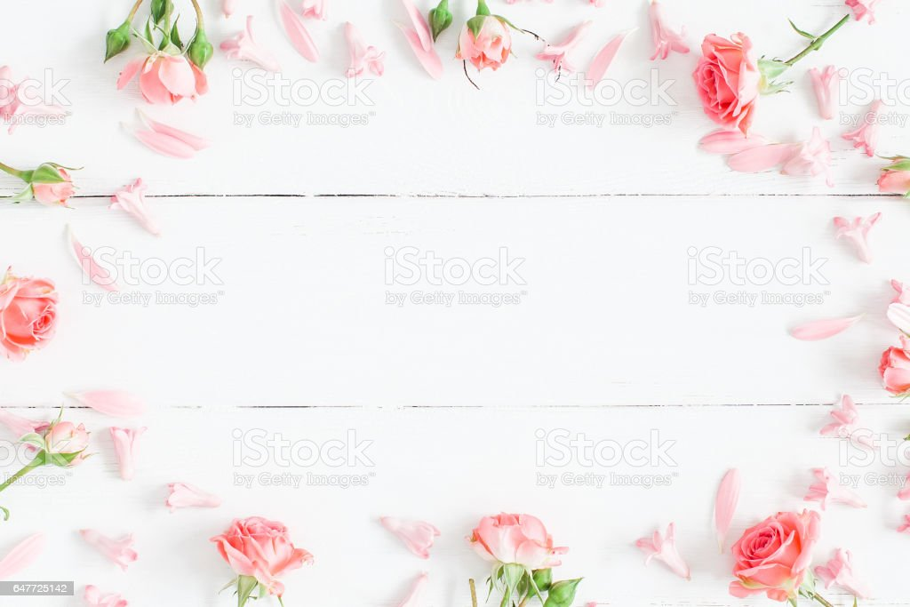 Pink flowers on white wooden background flat lay top view stock pink flowers on white wooden background flat lay top view royalty free stock mightylinksfo Choice Image