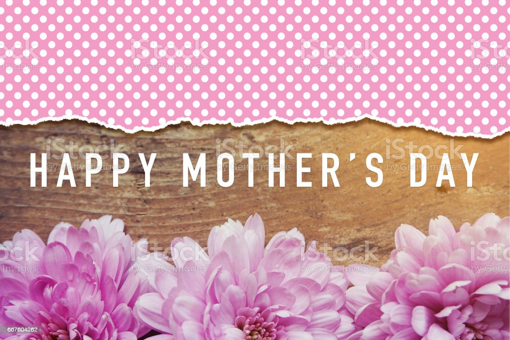 pink flowers on wooden with word Happy Mother's Day stock photo