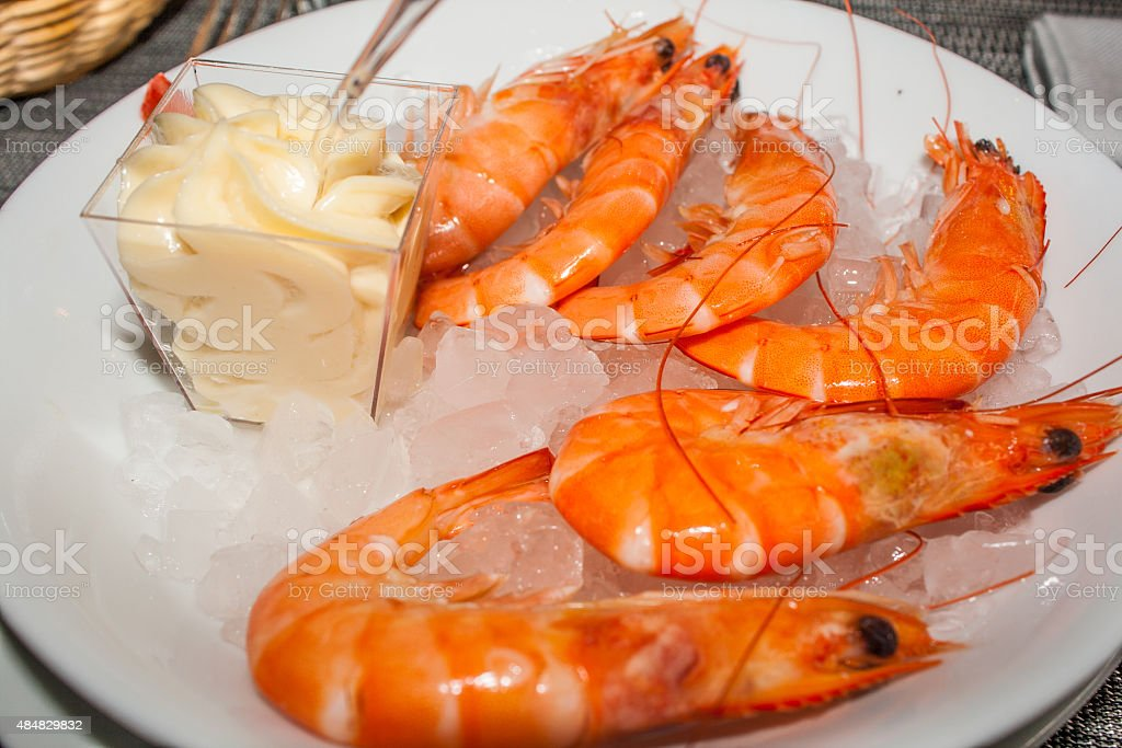 pink fresh prawns with mayonnaise and ice stock photo