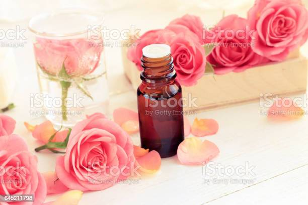 Pink fresh rose flowers and petals essential oil in dark glass bottle picture id645211798?b=1&k=6&m=645211798&s=612x612&h=c3nq 0kftccidooz0amxlzz9zmb7owmlsbouogl05me=