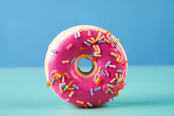 Pink frosted doughnut stock photo