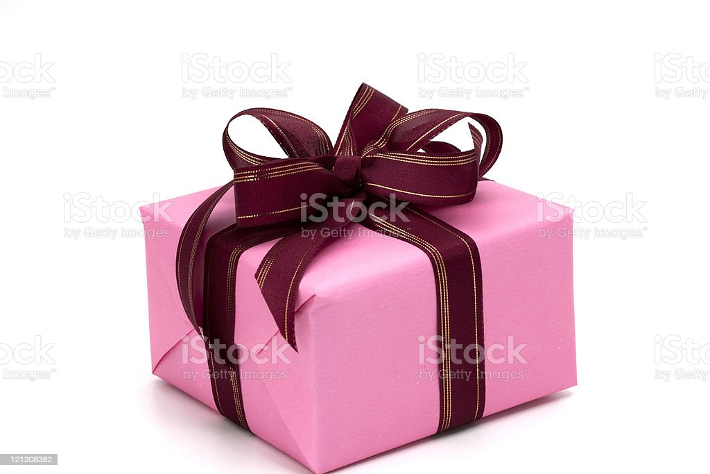Pink gift box secured with red and golden bow. royalty-free stock photo