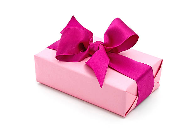pink gift box with purple bow stock photo