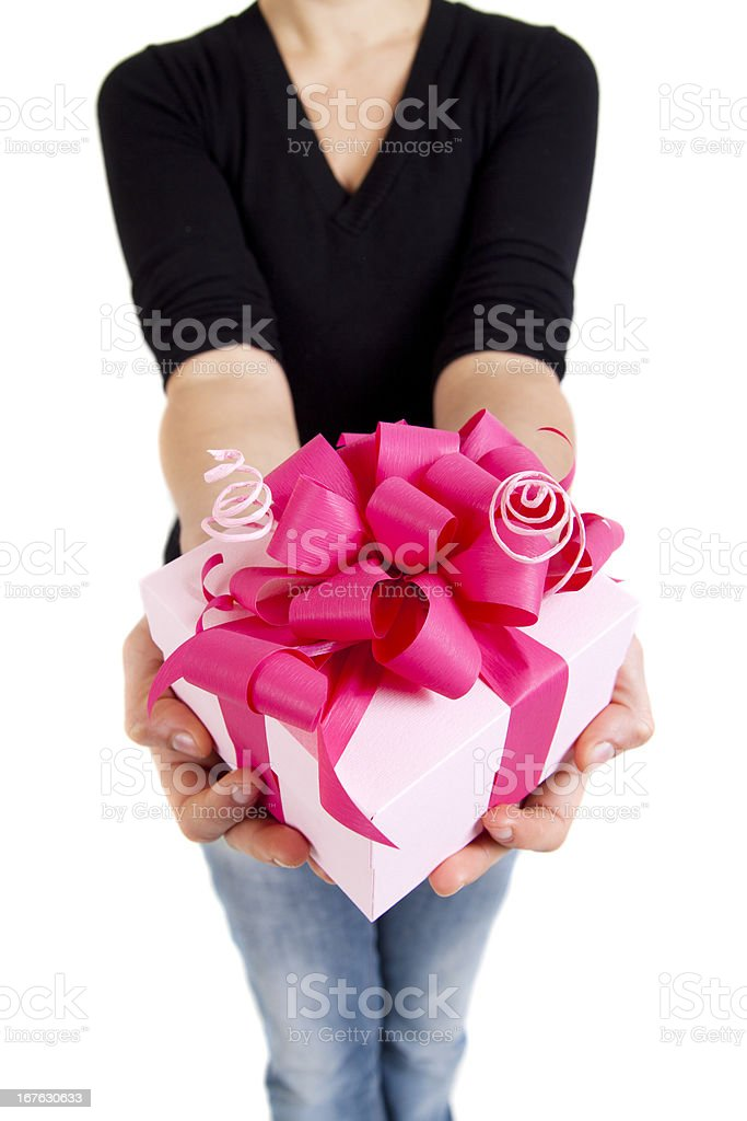 pink gift box with ribbon in woman hands royalty-free stock photo