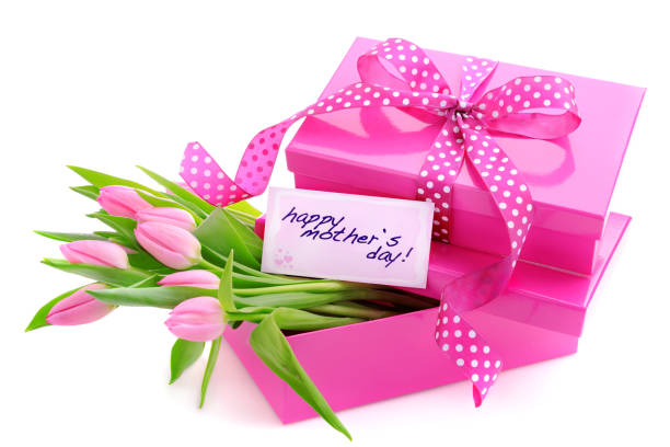 Pink gift boxes with a mothers day card and tulips stock photo