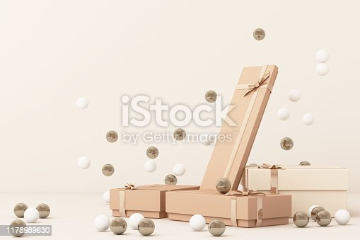 istock Pink  giftboxs  surrounding by a lot of gold and white ball. 3d rendering 1178989630