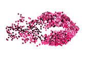 Pink stars glitter in the shape of broken kiss mark on white background
