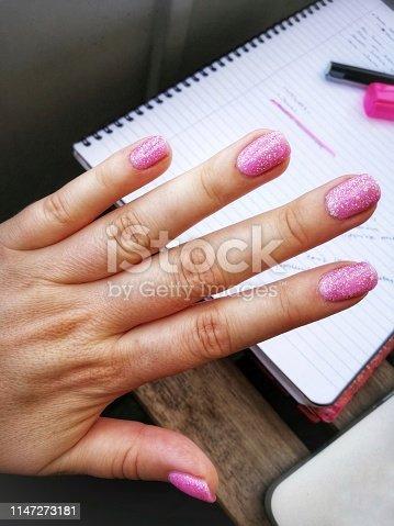 1147741037istockphoto Pink glitter nails 1147273181