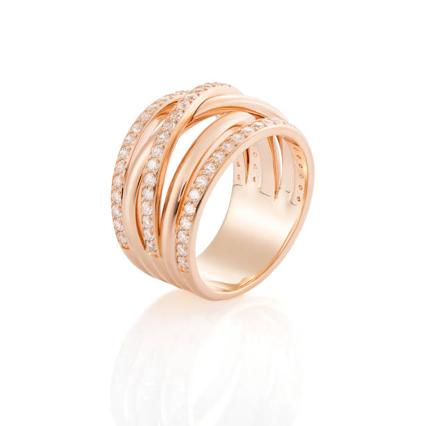 Pink gold ring with diamonds isolated on white background stock photo