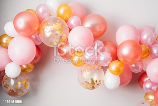 Pink golden balloon garland Festive decoration hanging on the wall
