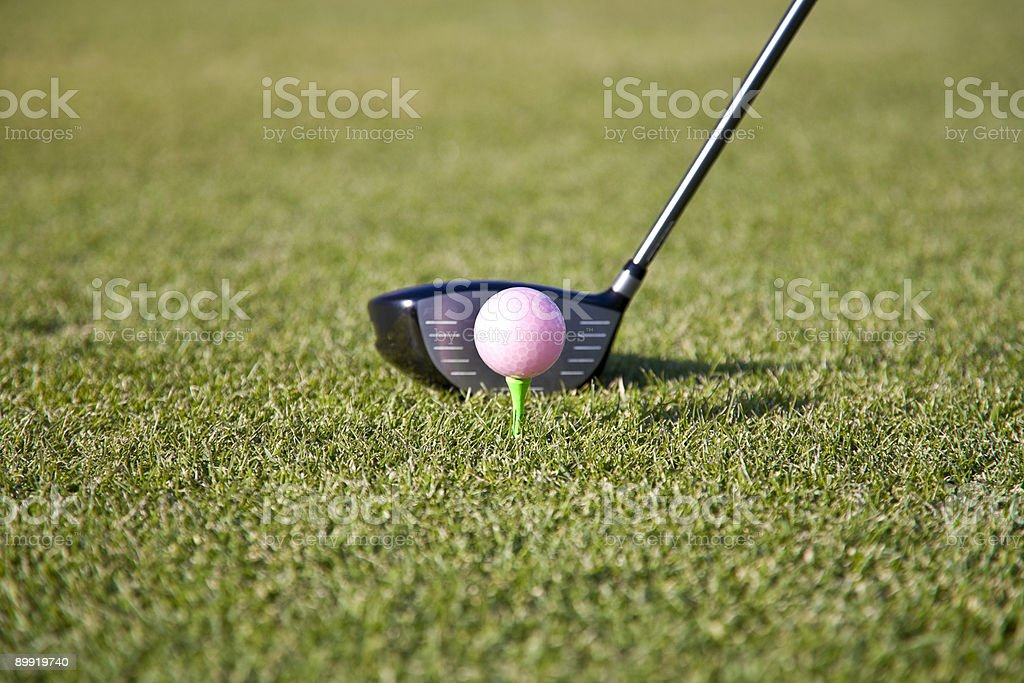 pink golf ball on tee