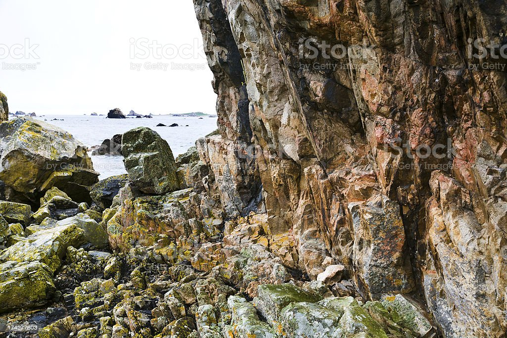 pink granite cliff in Brittany, royalty-free stock photo