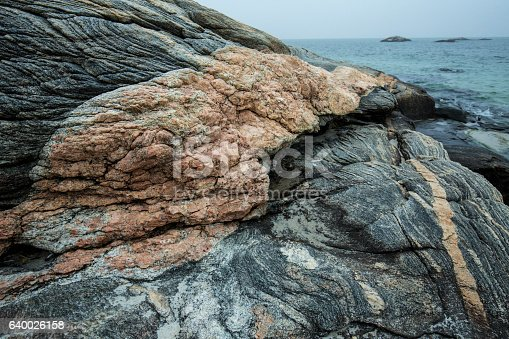 Pink granite intrusion in gneiss on the beach at Harkness Memorial State Park in Connecticut.