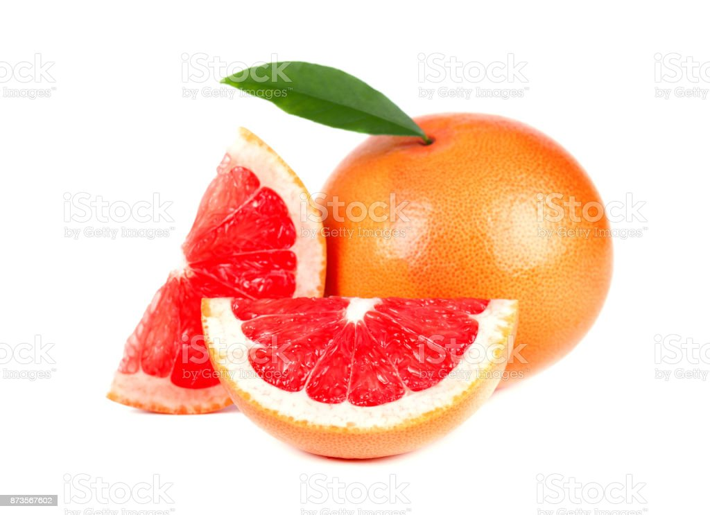 Pink grapefruit and slices isolated on white background with clipping path. Isolated grapefruits. Fresh grapefruit with green leaves isolated. stock photo