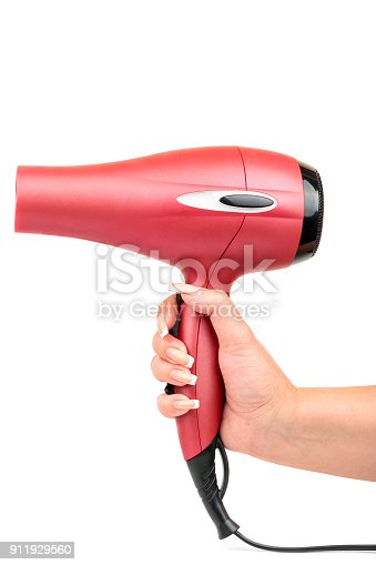 istock Pink hair dryer in hand 911929560