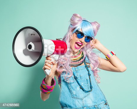 1166716628 istock photo Pink hair girl in funky manga outfit screaming into megaphone 474265560
