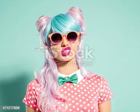 istock Pink hair manga style girl grimacing 474217638