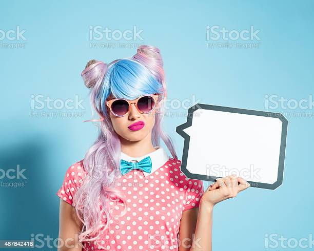 Pink Hair Manga Style Girl Holding Speech Bubble Stock Photo - Download Image Now