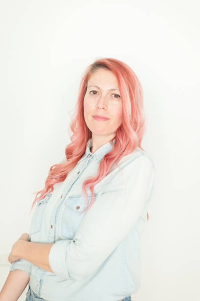 Pink haired woman portrait at home stock photo