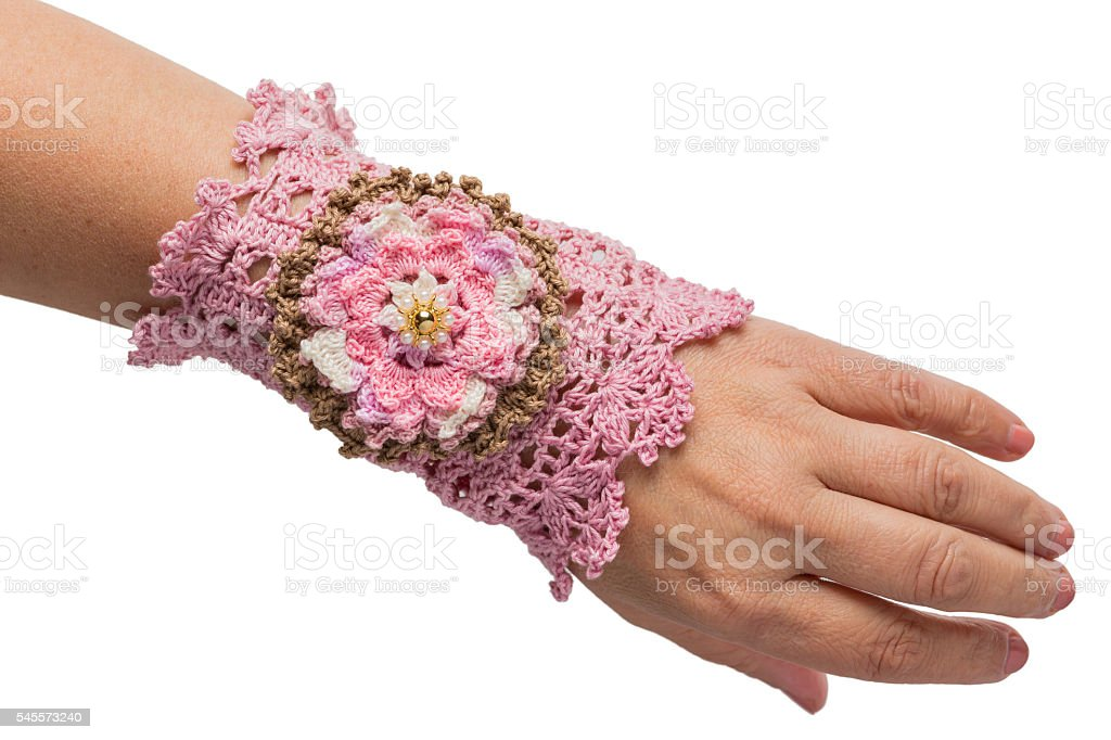 Pink hand- Knitted bracelet stock photo