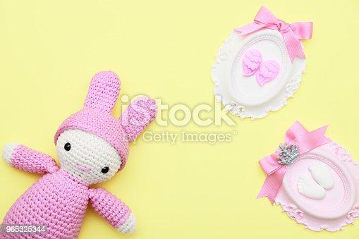 Pink Hand Made Baby Toy And Babyshower Stone Has Angel Wing Foot Ribbons On Yellow Flat Lay - Stockowe zdjęcia i więcej obrazów Anioł