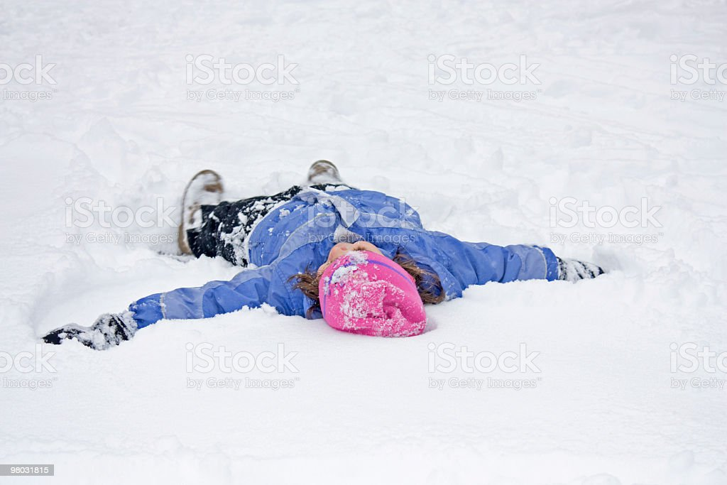 Pink Hat, Purple Coat. Winter Cold Snow Angel. royalty-free stock photo