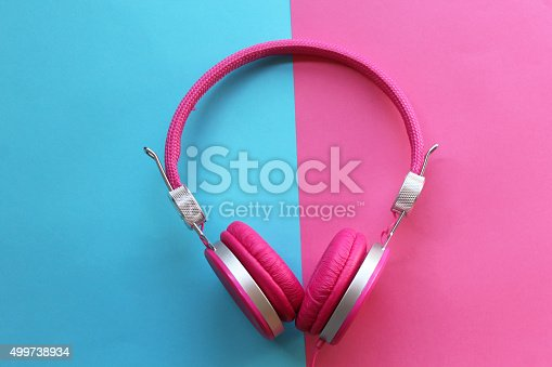 istock Pink headphones on colorful background 499738934
