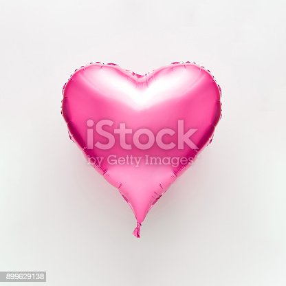 1078237178 istock photo Pink heart balloon on bright background. Minimal love concept. 899629138