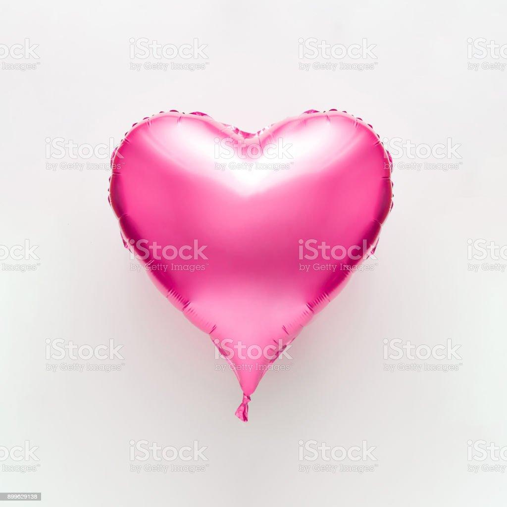 Pink heart balloon on bright background. Minimal love concept. stock photo