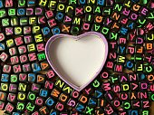 PInk heart shape inmidst colorful letters