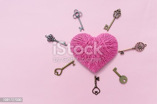 istock Pink heart with love key. Valentine's Day pink background. Top view.Greeting card.Copy space.old keys with pink heart isolated , sweet pink tone. Hobby concept.Colorful yarn 1091727030