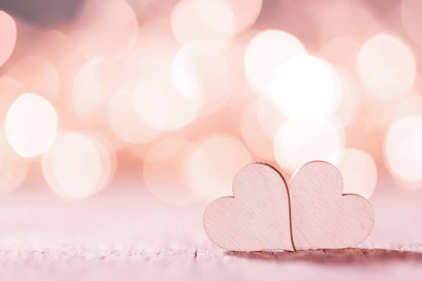 Pink hearts on bokeh background stock photo
