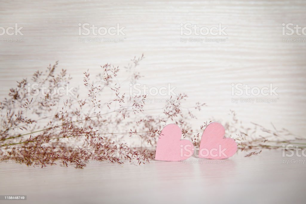 Two hearts, background for greetings on Valentine\'s Day. Wooden...