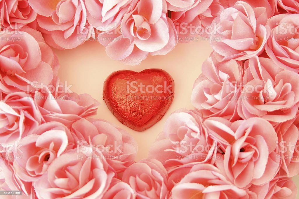 Pink Heart-Shaped Valentine Wreath With Chocolate royalty-free stock photo