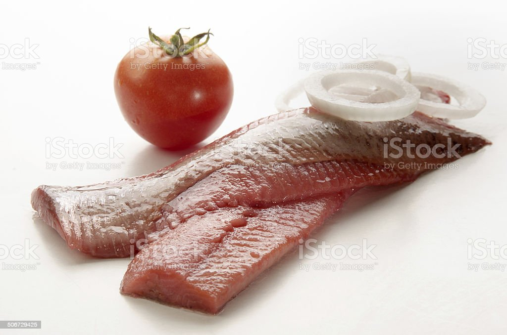 pink herring with onion and tomato stock photo