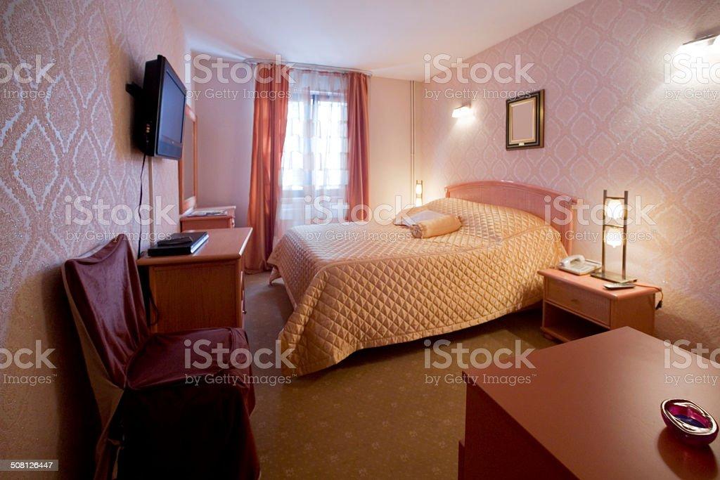 Pink hotel room interior stock photo