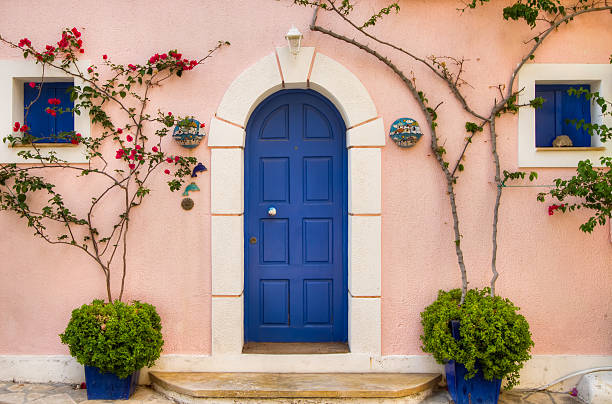 Pink house with Blue Door stock photo