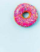 Pink iced donut background